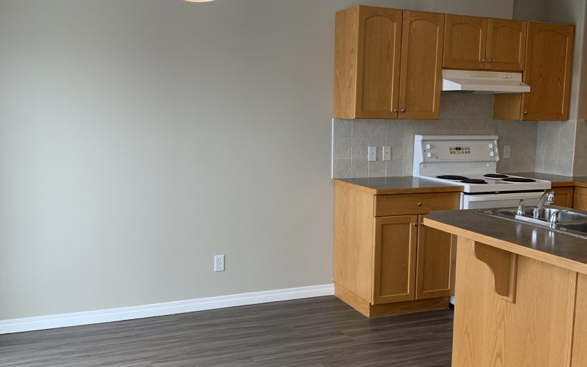 Airdrie: 3 Bedroom Townhouse with Double attached Garage and Developed Basement!