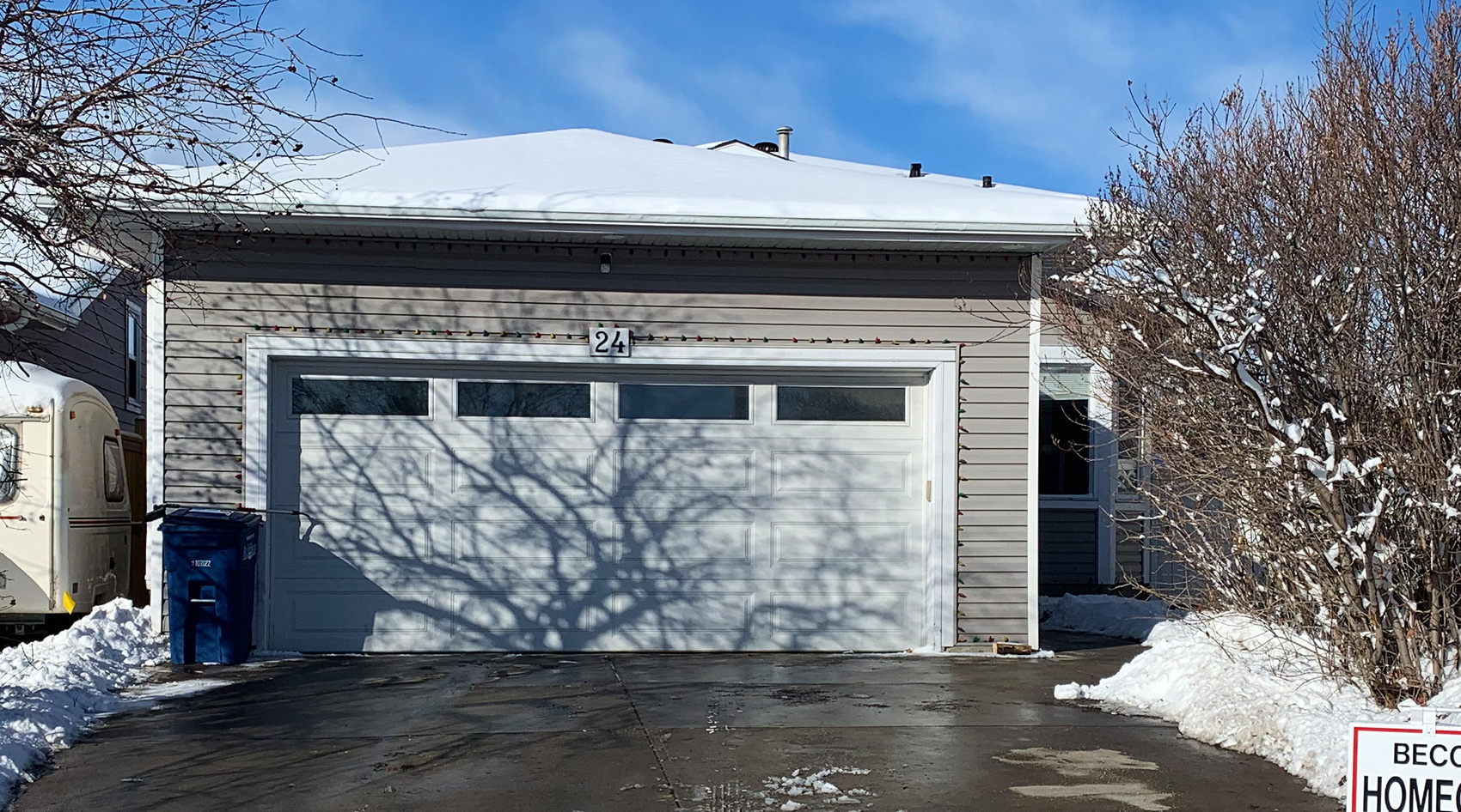 Airdrie: 4 Bedroom 4-level Split Home with Double Attached Garage and Huge Fenced Lot!